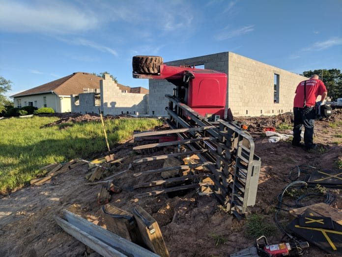 Forklift topples and traps construction worker