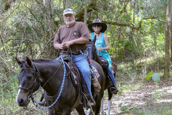 Lee Adams from Sumter County and Dana Proeger from Brooksville ride the trails at Tucker Hill, a trail head of the Withlacoochee State Forest