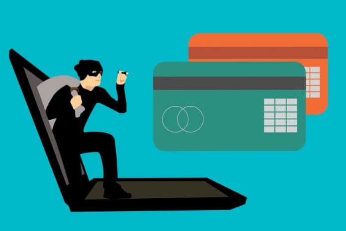 Graphic of thief stealing credit cards