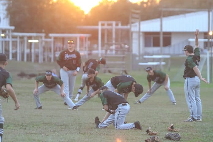 Weeki Wachee baseball players warm-up before playing Fivay on Thursday night at Central High School.