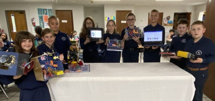 Upper elementary students with their Technology Day projects