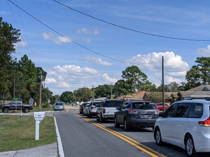 Pickup line at JD Floyd Elementary in Spring Hill. Cars are backed up onto Coronado.