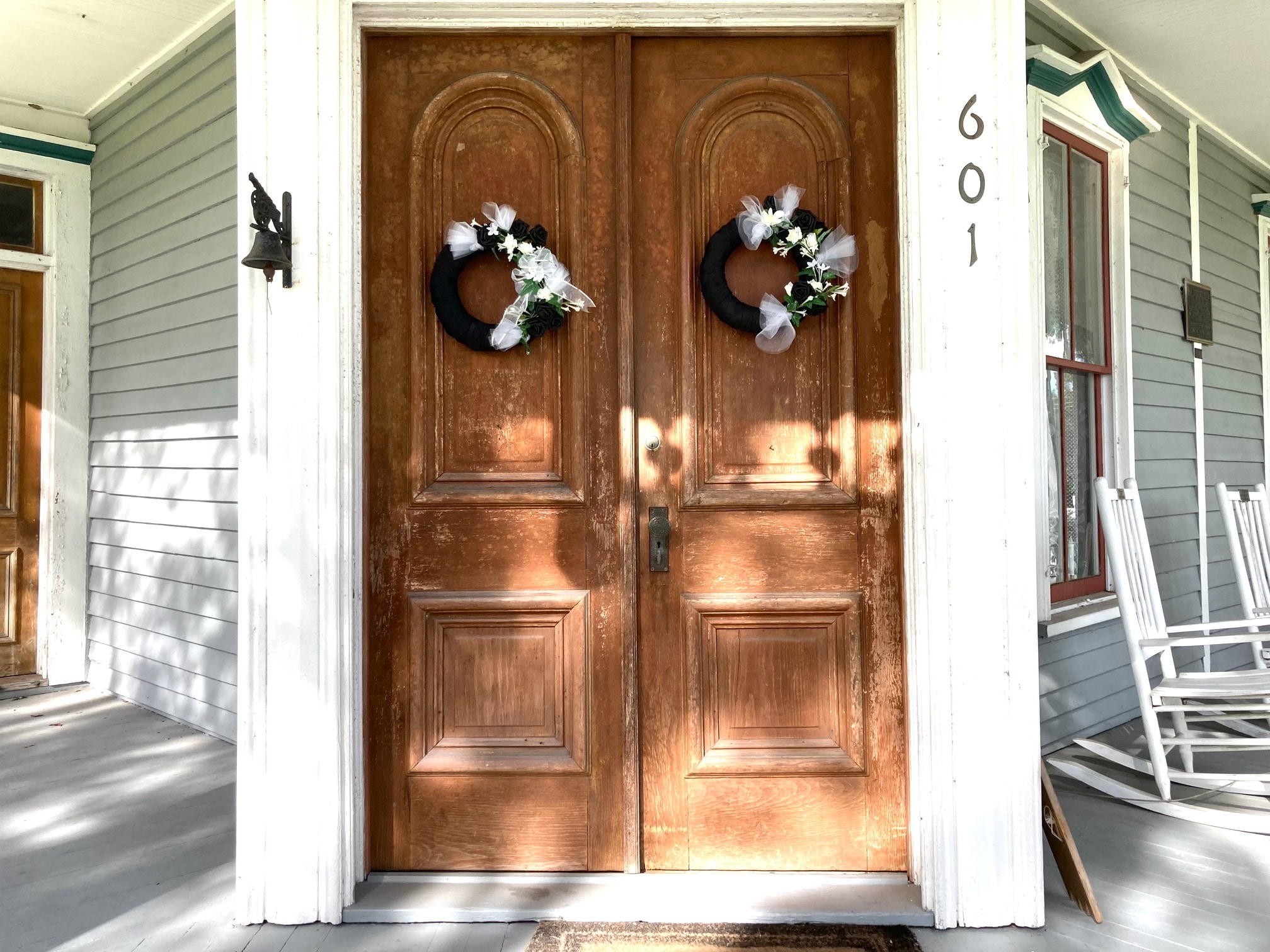 Mourning wreaths on the front doors of the May-Stringer Museum in Brooksville