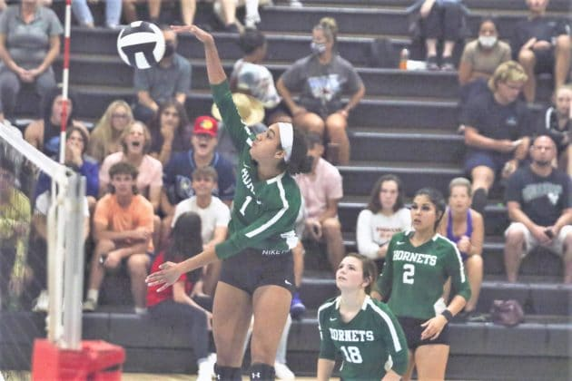 Hornets Danielle Mcgee (1) spikes the ball over the net during the volleyball match on Tuesday, Sept. 21, 2021, at Nature Coast Tech. Photo by Alice Mary Herden